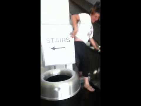Girl slides down the side of escalator and smashes her face!