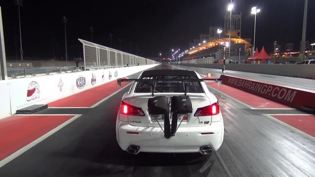 Race car takes flight and jumps a safety barrier