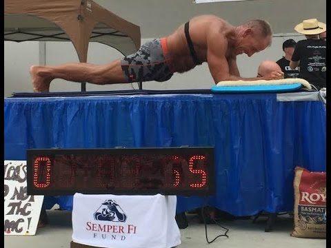 new record for longest held plank set by 57 year old man