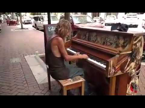 Homeless man plays public piano