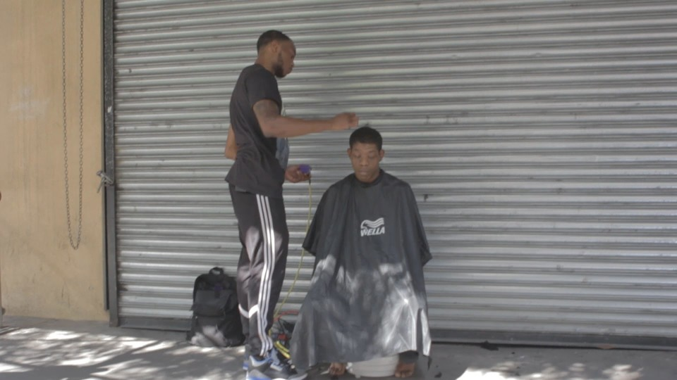 barber gives the homeless free haircuts