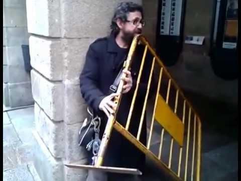 Men Plays a Street Rail as a Flute